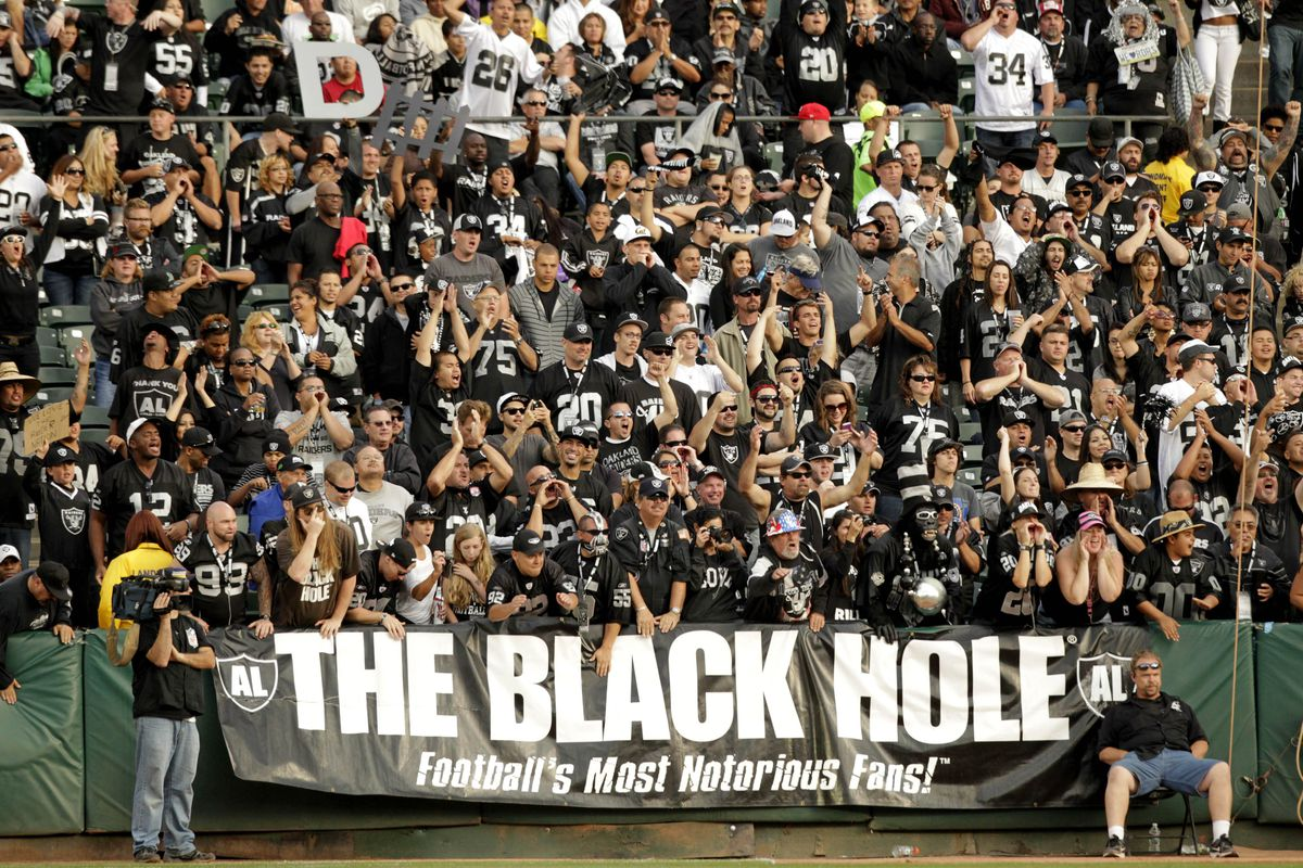 Fans in the Black Hole cheer during action between the Oakland Raiders and the Detroit Lions in the fourth quarter at O.co Coliseum.