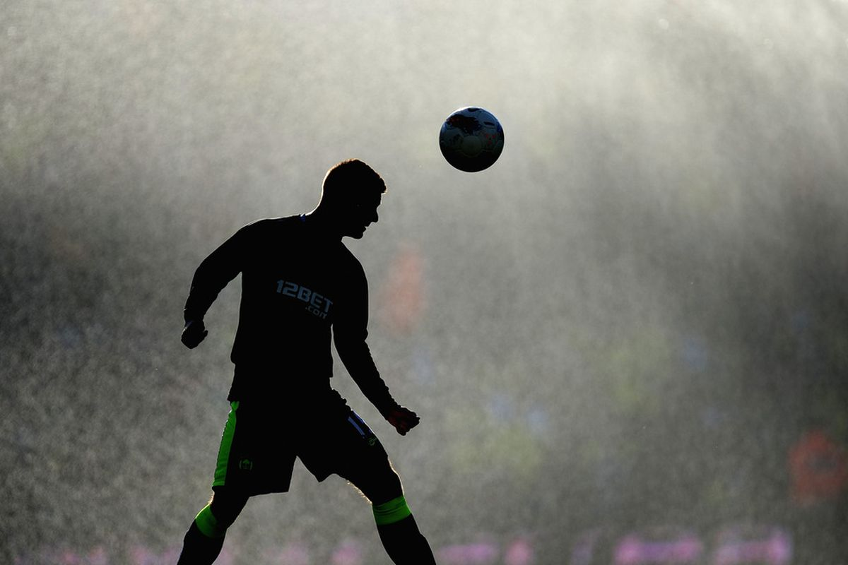 Callum McManaman of Wigan warms up during the Barclays Premier League match between Norwich City and Wigan Athletic at Carrow Road.