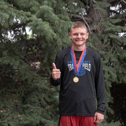 Fremont High's Logan Tittle poses with a medal.