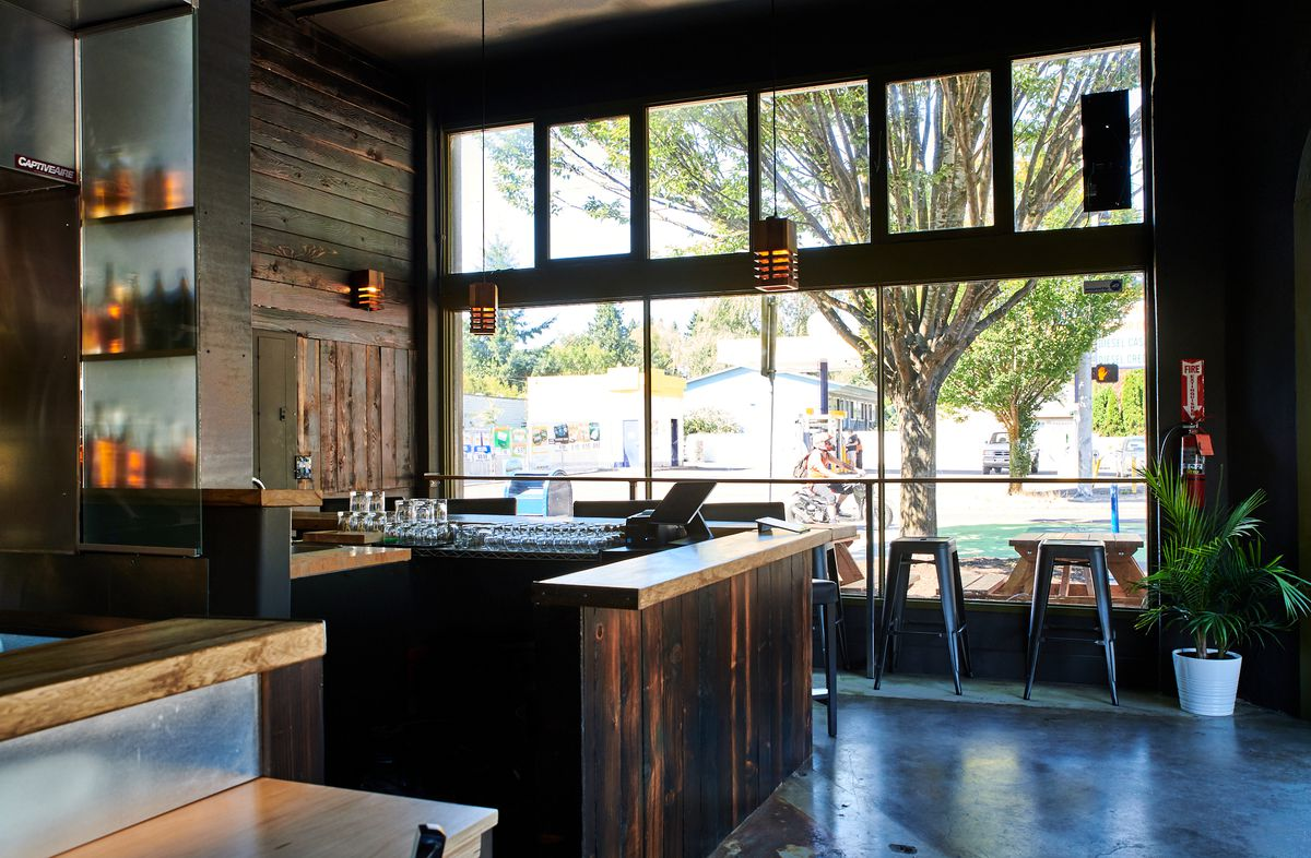 A picture of tall windows and a bar at Hapa Ramen