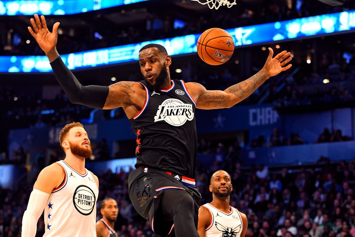Team LeBron forward LeBron James of the Los Angeles Lakers dunks the ball against Team Giannis guard Kemba Walker of the Charlotte Hornets during the 2019 NBA All-Star Game at Spectrum Center.