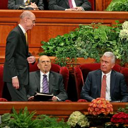 President Thomas S. Monson and President Dieter F. Uchtdorf, right,, watch as first counselor President Henry B. Eyring approaches the podium in the morning session of the 183rd Semiannual General Conference of the Church of Jesus Christ of Latter-day Saints Sunday, Oct. 6, 2013, in Salt Lake City.