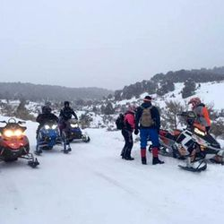 Search and rescue crews gather near the scene of a fatal plane crash near Meeker, Colorado, on Friday Jan. 15, 2016.