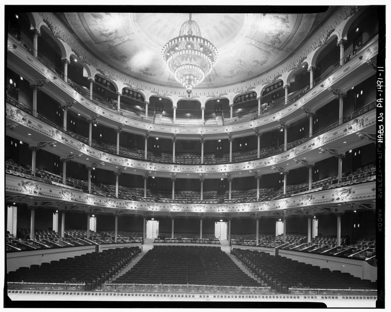 The interior of the Academy of Music in Philadelphia. There are multiple balconies and a large seating area on the main level.