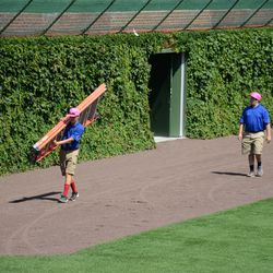2:27 p.m. Ladder being returned to the left field corner storage area -