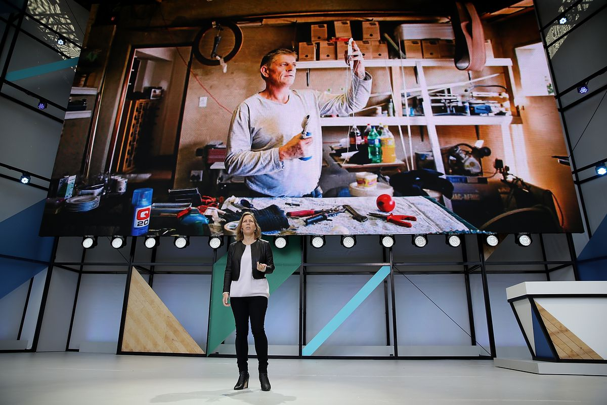 YouTube CEO Susan Wojcicki onstage in front of a large video screen