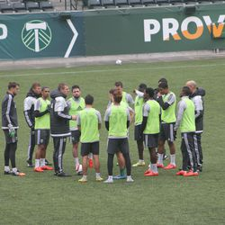 Knowles gives instruction to the green team ahead of the scrimmage.