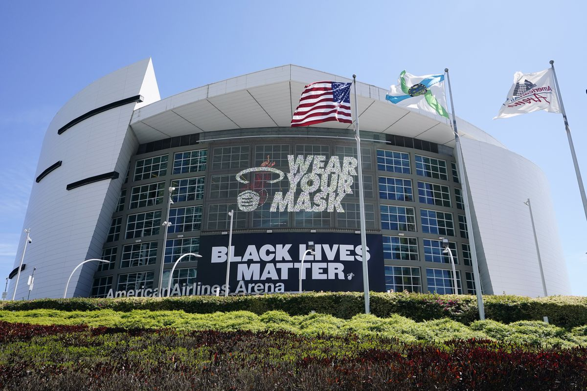 """A """"Black Lives Matter"""" banner and """"Wear Your Mask,"""" are displayed on the front of the American Airlines Arena where the Miami Heat normally play basketball, Monday, Sept. 28, 2020, in Miami. The Heat won the Eastern Conference title on Sunday night, clinching that series a day after the Lakers won the Western Conference crown."""