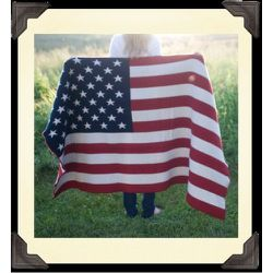 """<a href=""""https://mettlersamerica.com/index.php?route=product/product&path=63_79&product_id=356"""">Stars and Stripes Throw Blanket</a>, $150 at Mettler's American Mercantile."""