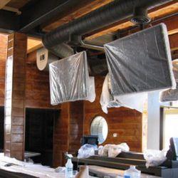 Flat-screen TVs will hang over the bar