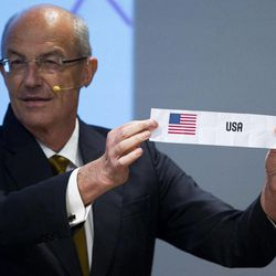 FIBA's Sport Director Lubomir Kotleba shows the name of a country during the draw for the London 2012 Olympic women's basketball tournament in Rio de Janeiro, Brazil, Monday, April 30, 2012. Basketball at the London 2012 Olympic Games will be held from July 28 to Aug. 12.