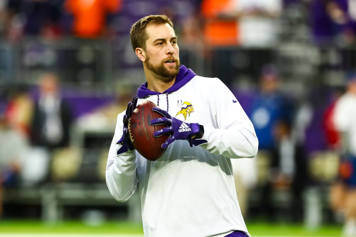 Minnesota Vikings wide receiver Adam Thielen participates in warm-ups before the start of a game against the Denver Broncos at U.S. Bank Stadium.