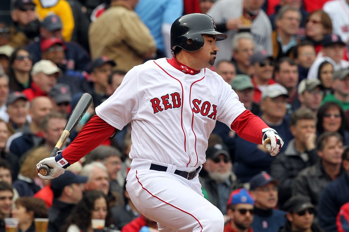 BOSTON, MA - APRIL 8:   Adrian Gonzalez #28 of the Boston Red Sox knocks in a run in the second inning against the New York Yankees on Opening Day at Fenway Park on April 8, 2011 in Boston, Massachusetts. (Photo by Jim Rogash/Getty Images)