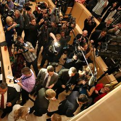 Media members swarm as Mitt Romney, former governor of Massachusetts, leaves after addressing the Hinckley Institute of Politics regarding the state of the 2016 presidential race. The speech took place at the University of Utah in Salt Lake City on Thursday, March 3, 2016.