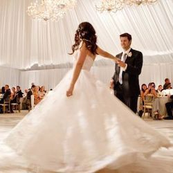 """""""To me, this is an iconic wedding moment captured on film. It is a eternal shot that sums up the evening: beautiful bride, handsome groom, and that twirl says it all: elegant, sophisticated, fun and fabulous."""""""