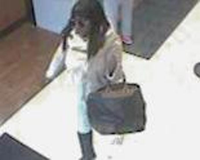 Surveillance image of a woman who robbed a Chase Bank branch April 6, 2019, at 3033 N. Pulaski Road.