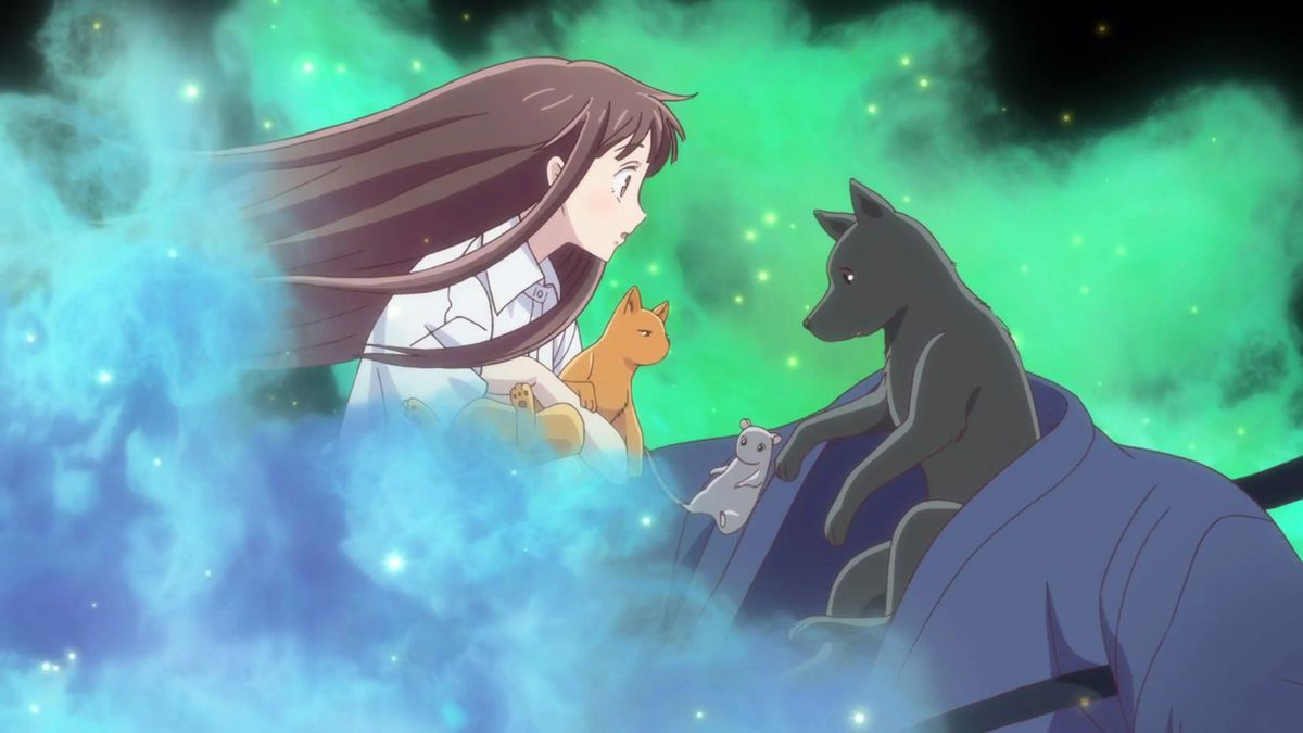 tohru holding a cat and a rat and seeing shigure transformed into a dog