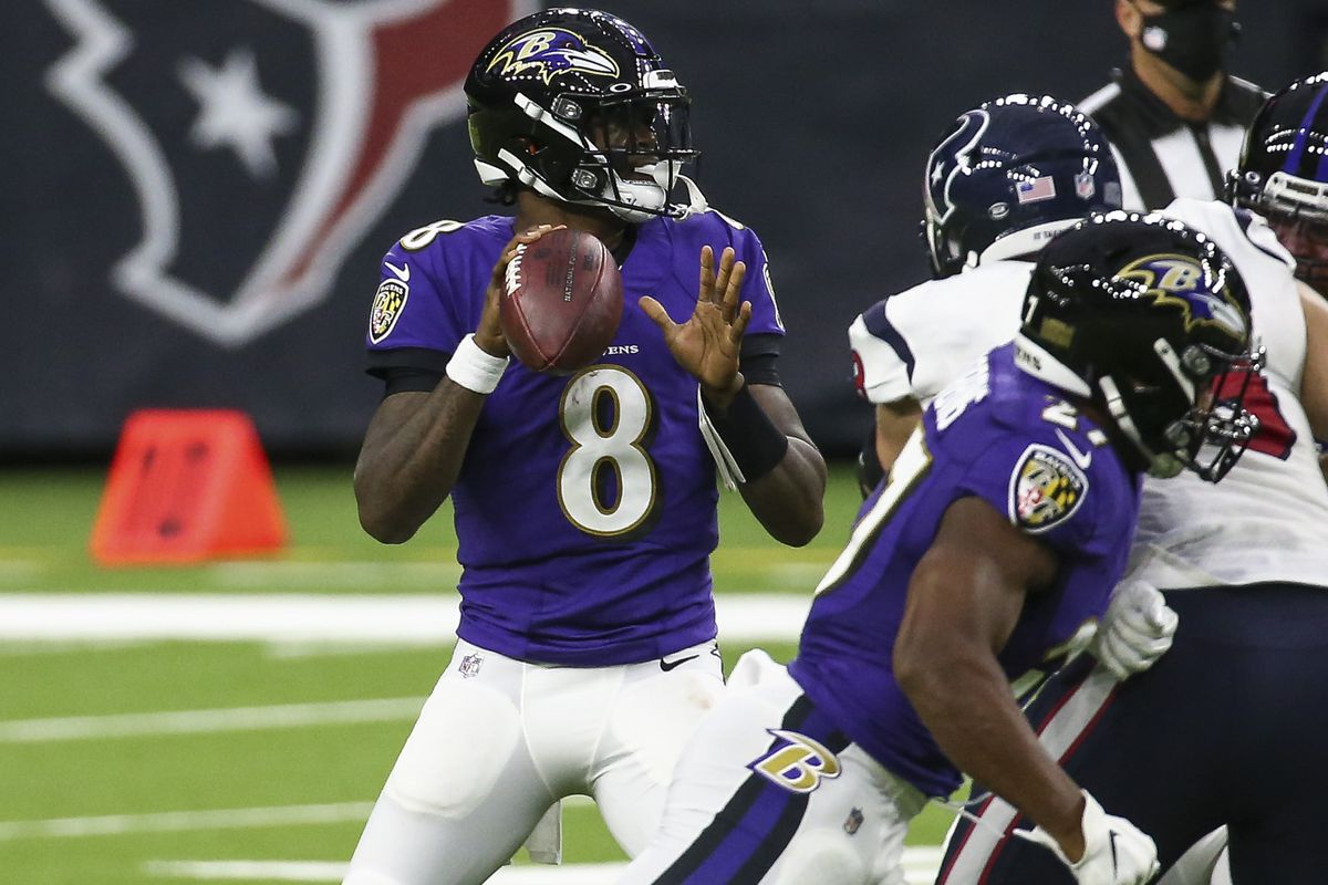 Baltimore Ravens quarterback Lamar Jackson looks for an open receiver during the second quarter against the Houston Texans at NRG Stadium.