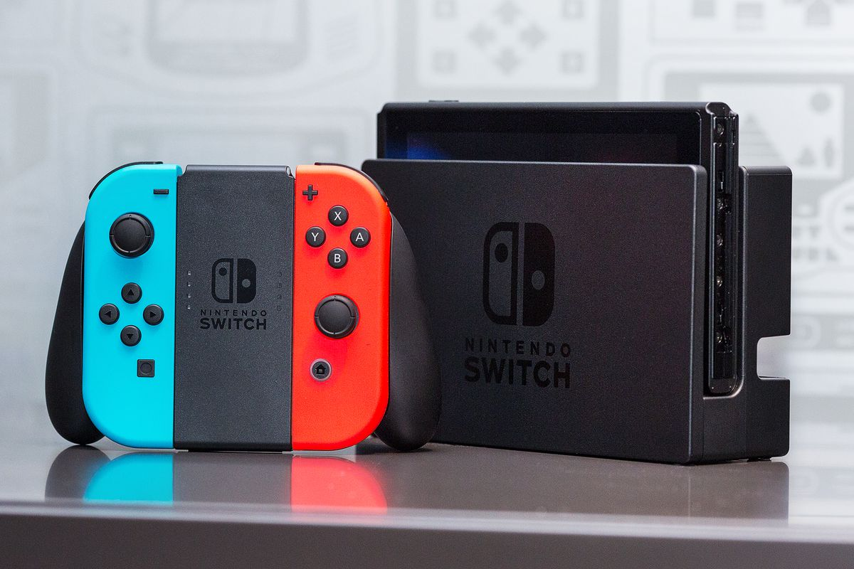 The Nintendo Switch in its dock, with the Joy-Con grip.