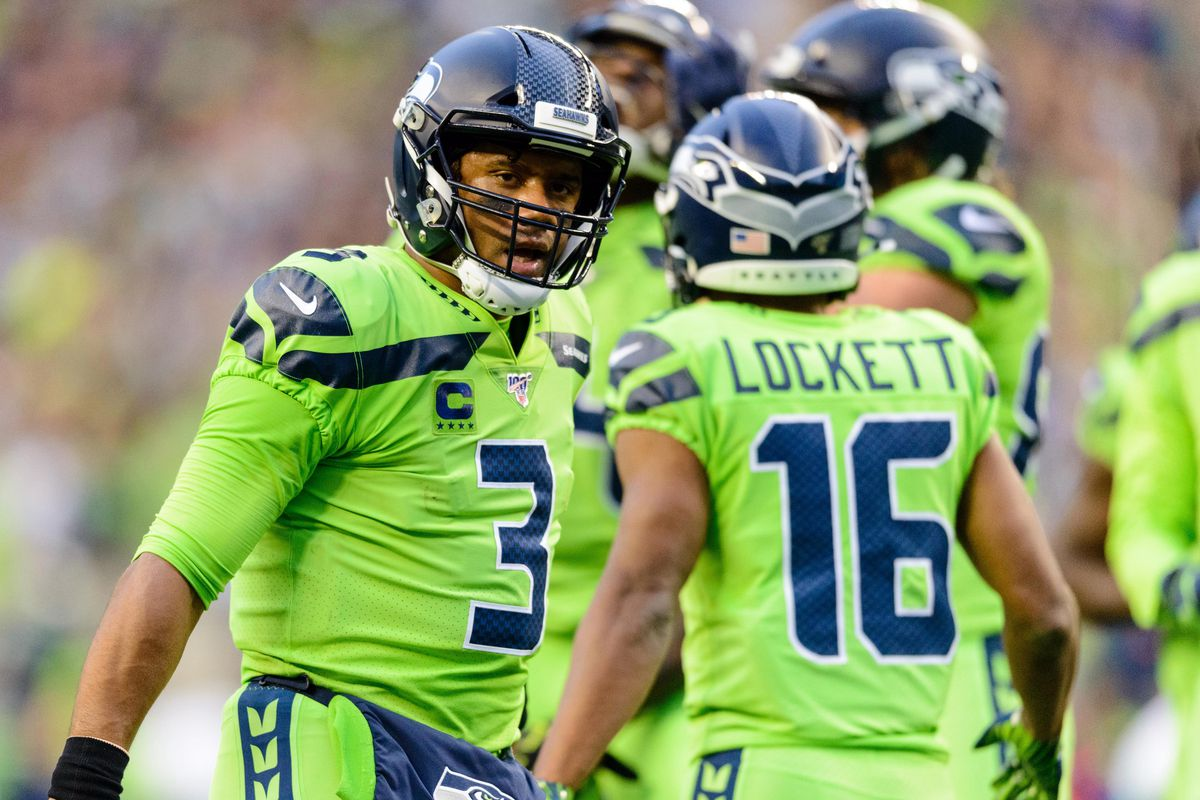Seahawks quarterback Russell Wilson and Seattle Seahawks wide receiver Tyler Lockett during the during the first half against the Los Angeles Rams at CenturyLink Field.