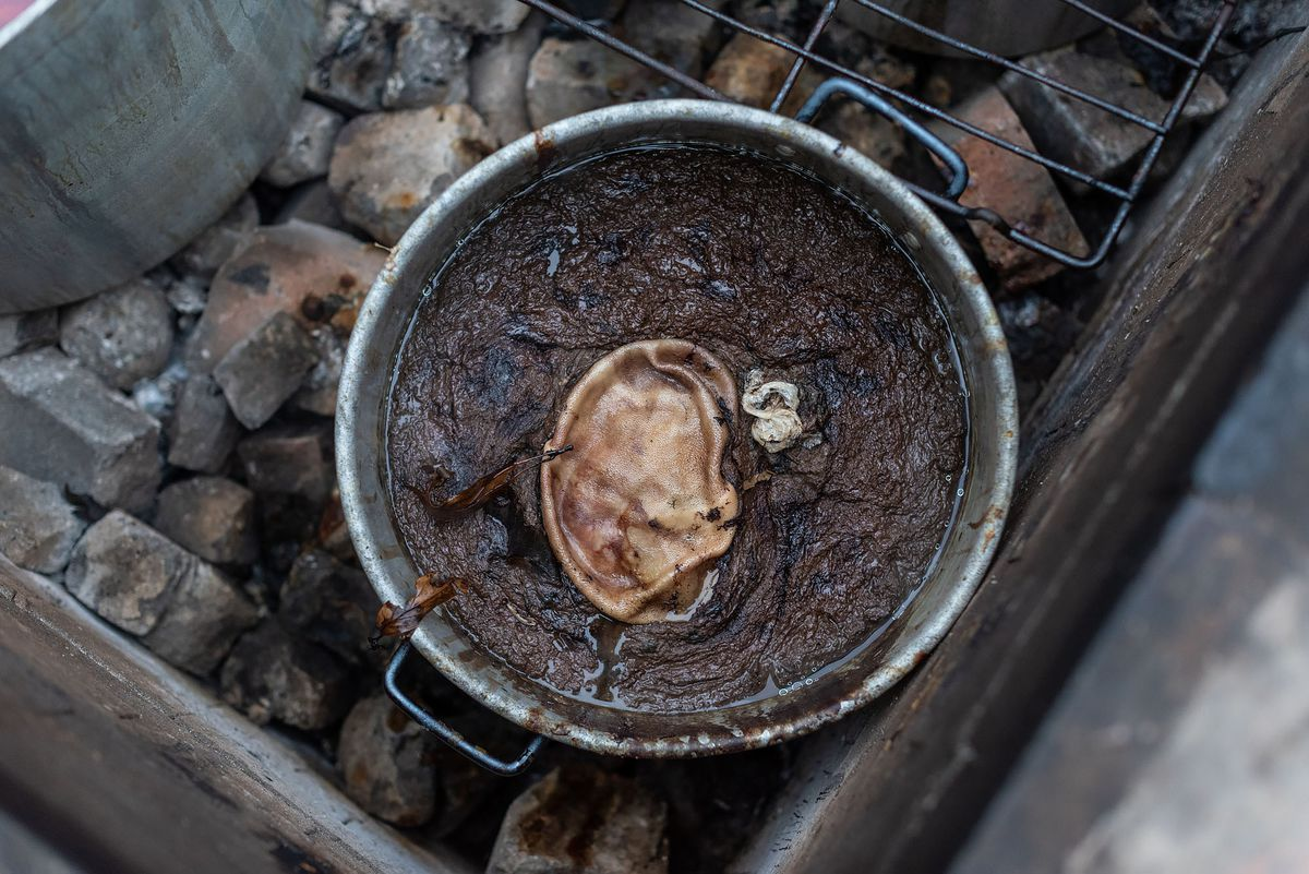 Blood sausage pot inside the Bautistas' underground pit.