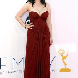Kat Dennings arrives at the 64th Primetime Emmy Awards at the Nokia Theatre on Sunday, Sept. 23, 2012, in Los Angeles.