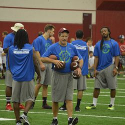 Camp coaches and counselors huddle. Former Wisconsin safety and current Atlanta Falcon Dezmen Southward is on the right.