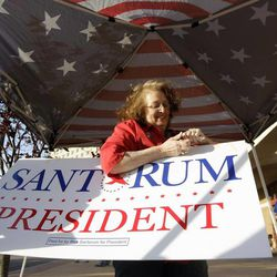 Laurice Cox, a supporter of Rick Santorum, holds a  sign for the former presidential candidate outside a caucus location Tuesday, April 10, 2012, in St. Charles, Mo. The original caucus held March 17 turned into chaos amid rules disputes and claims of favoritism, and adjourned with police arresting two people and no delegates selected.