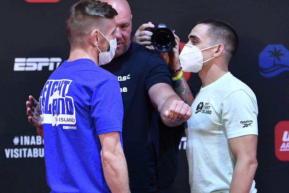 Opponents Tim Elliott and Ryan Benoit face off during the UFC Fight Night weigh-in inside Flash Forum on UFC Fight Island on July 14, 2020 in Yas Island, Abu Dhabi, United Arab Emirates.