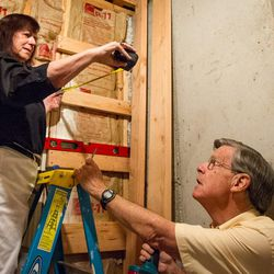Carol and Ed Diener measure how far out the shelves are going to reach for their basement shelf set in Salt Lake City, Utah, on Monday, Aug. 28, 2017. Ed, a research psychologist, and Carol, a clinical psychologist, have applied principles of happiness and well-being to their family life and their lives together.