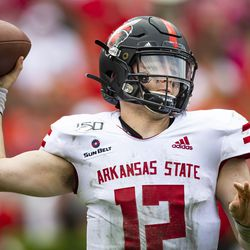 Arkansas State quarterback Logan Bonner passes against Georgia during an NCAA football game on Saturday, Sept. 14, 2019 in Athens, Ga. Bonner is one of a handful of players who has transferred into the Utah State program.