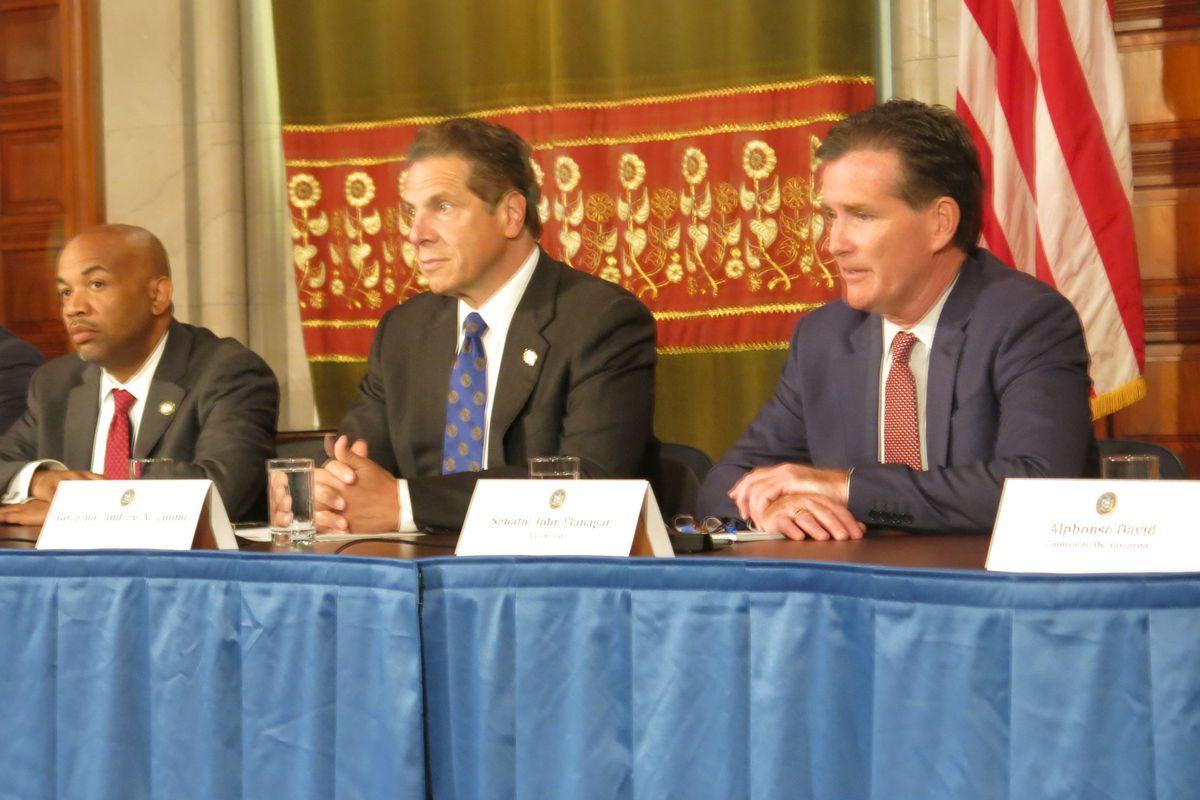 Assembly Speaker Carl Heastie, left, Gov. Andrew Cuomo, and Senate leader John Flanagan.