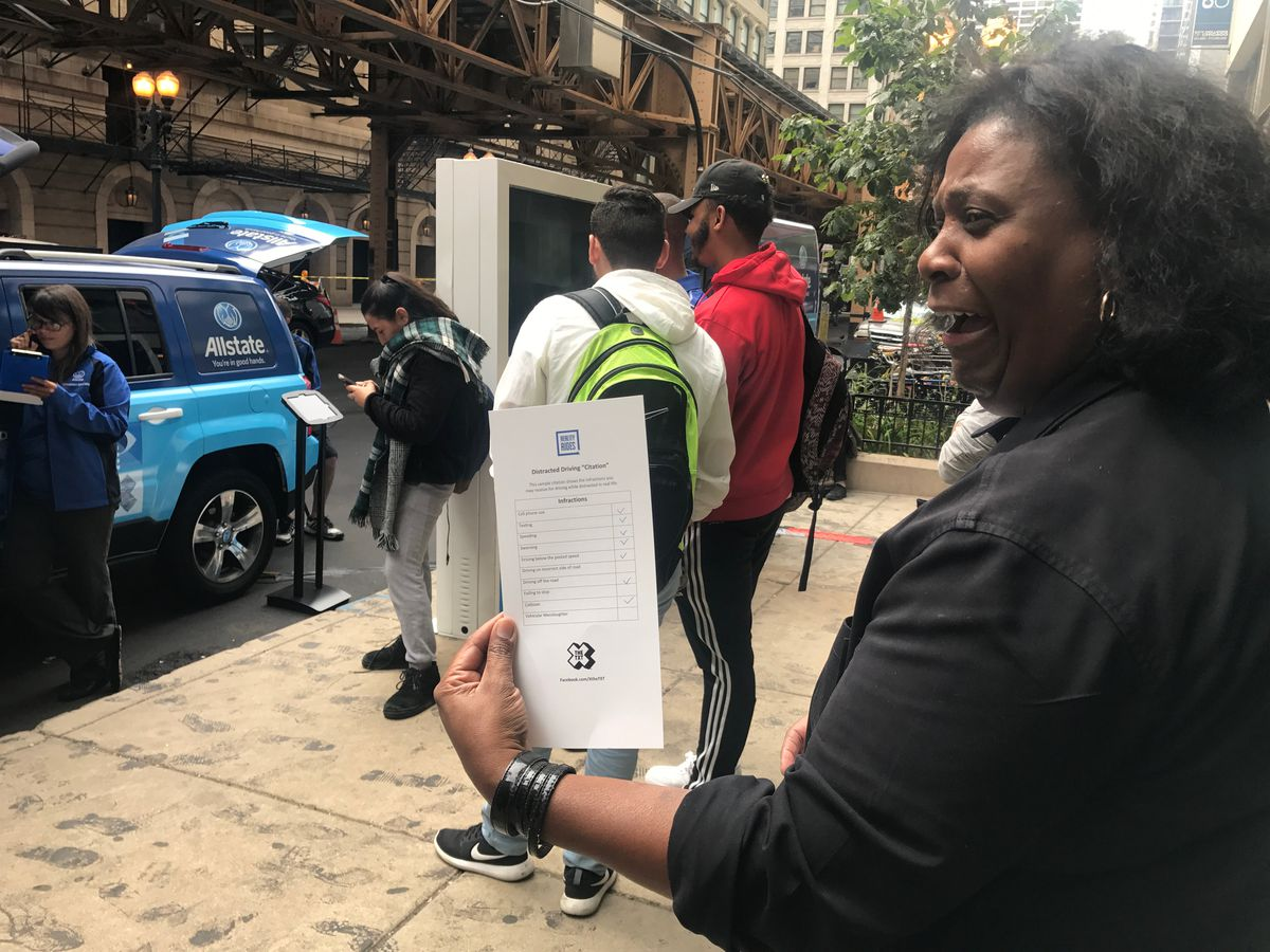 Hilda Thompson, an Allstate agent in the South Loop, looks over the infractions she committed while using the driving simulator. | Taylor Hartz/For the Sun-Times
