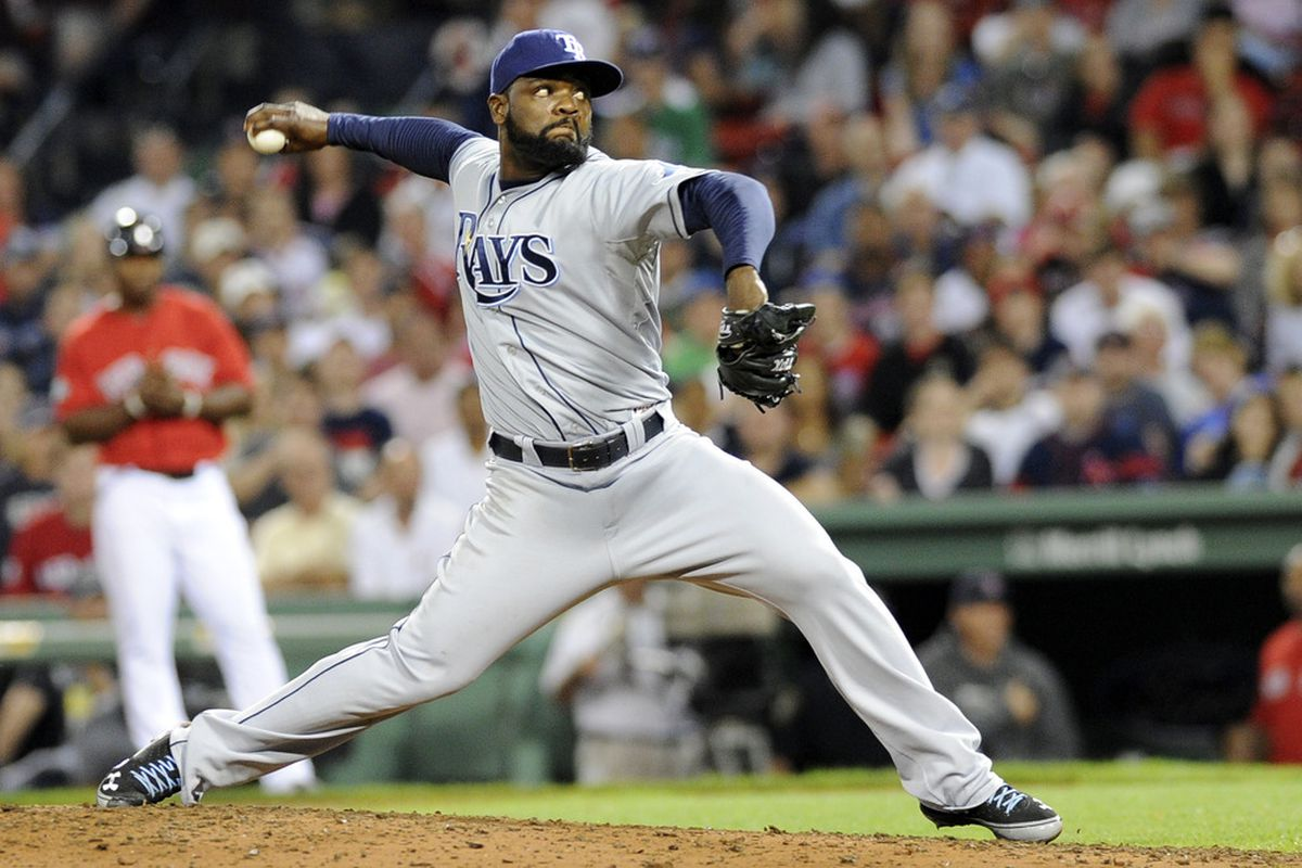 May 25, 2012; Boston, MA, USA; Tampa Bay Rays relief pitcher Fernando Rodney (56) pitches during the ninth inning against the Boston Red Sox at Fenway Park. Mandatory Credit: Bob DeChiara-US PRESSWIRE