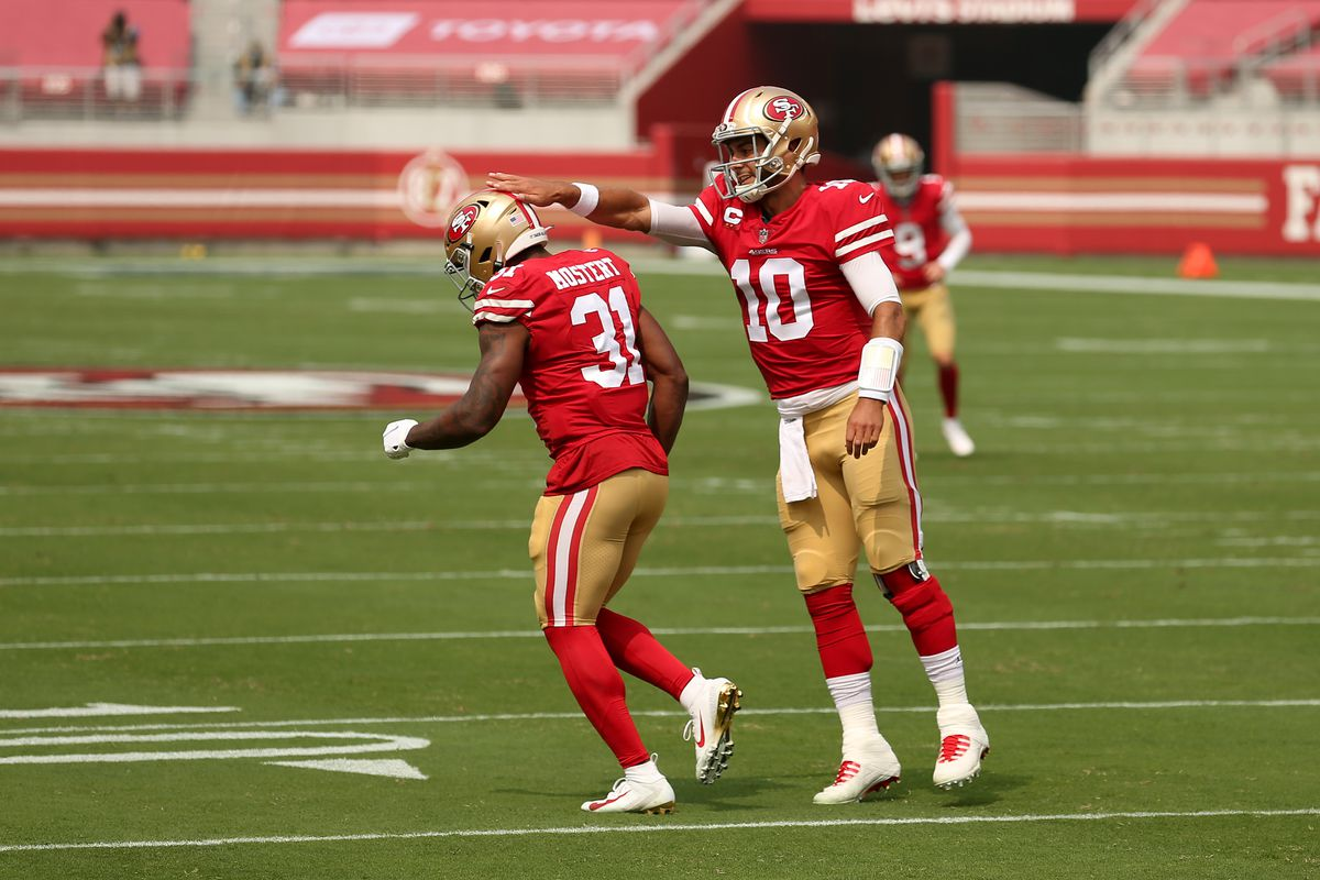 Raheem Mostert #31 of the San Francisco 49ers is congratulated by Jimmy Garoppolo #10 after scoring a touchdown against the Arizona Cardinals at Levi's Stadium on September 13, 2020 in Santa Clara, California.