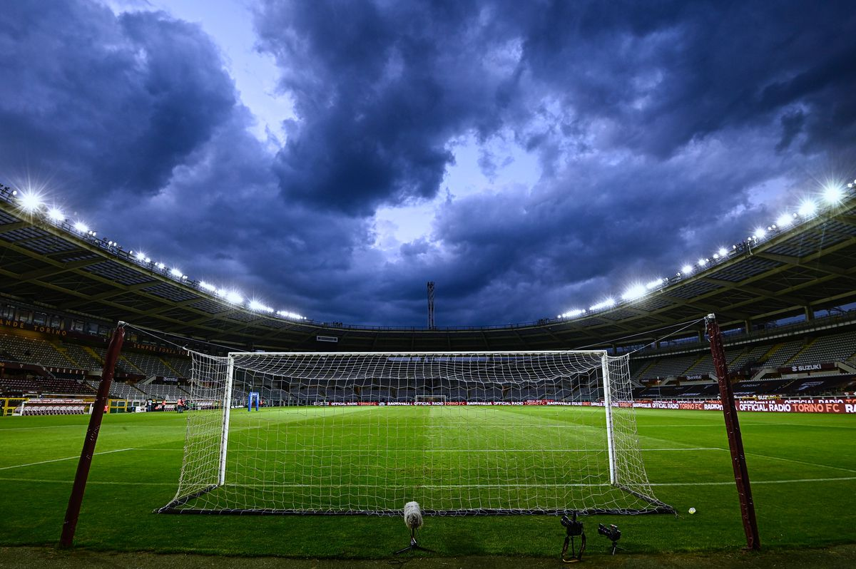Photo of a view of the goal and the pitch at the empty stadium Olimpico Grande Torino in Italy.