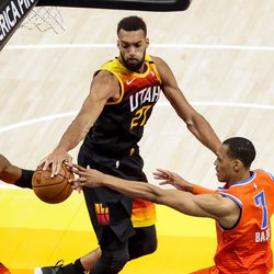 Utah Jazz center Rudy Gobert (27) snags a pass away from Oklahoma City Thunder forward Darius Bazley (7) during the game at Vivint Smart Home Arena in Salt Lake City on Tuesday, April 13, 2021.