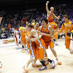 Timpview players celebrate their 55-43 win over Mountain Crest in the 4A boys state championship game Saturday at the Dee Events Center in Ogden.