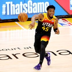 Utah Jazz guard Donovan Mitchell (45) baseball passes the ball across court as the Utah Jazz and the Memphis Grizzlies play in game 5 at Vivint Arena in Salt Lake City on Wednesday, June 2, 2021. Utah won 126-110, Utah advances to the second round.