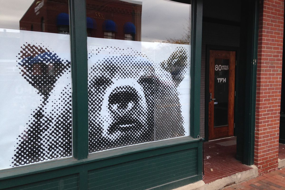 The bear-stare on the exterior of The Honey Paw.