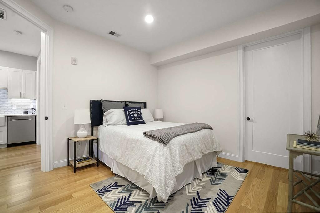 A bedroom with a large closet and a closed closet door.