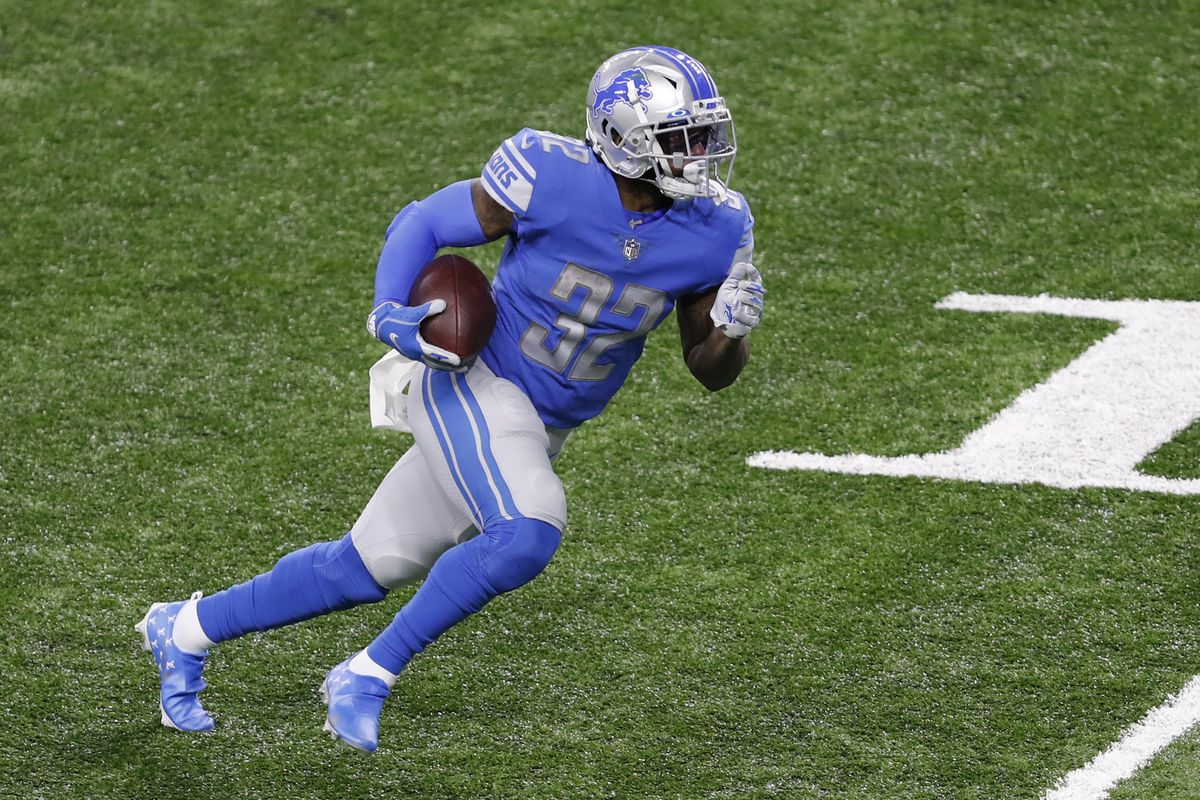 Detroit Lions running back D'Andre Swift runs after a catch for a touchdown during the third quarter against the Washington Football Team at Ford Field.