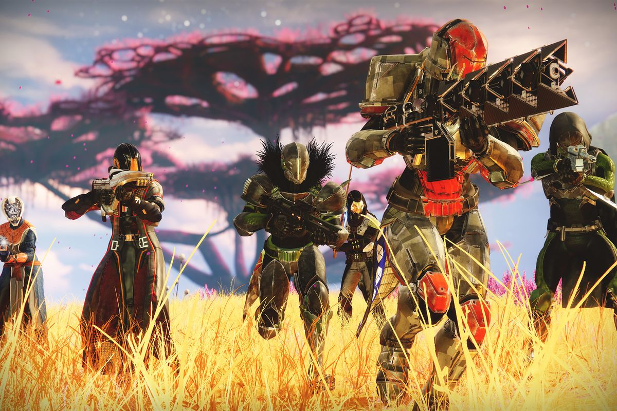 a team of six Guardians running through straw-colored grass in Destiny 2: Beyond Light