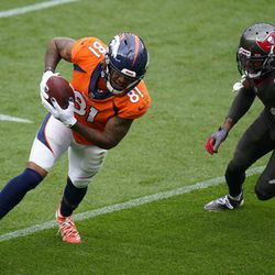Denver Broncos wide receiver Tim Patrick moves past Tampa Bay Buccaneers cornerback Carlton Davis on his way to scoring a touchdown during the first half of an NFL football game Sunday, Sept. 27, 2020, in Denver.