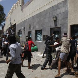 """Yemeni protestors break windows of the U.S. Embassy during a protest about a film ridiculing Islam's Prophet Muhammad, in Sanaa, Yemen, Thursday, Sept. 13, 2012. Dozens of protesters gather in front of the US Embassy in Sanaa to protest against the American film """"The Innocence of Muslims"""" deemed blasphemous and Islamophobic. (AP Photo/Hani Mohammed)"""
