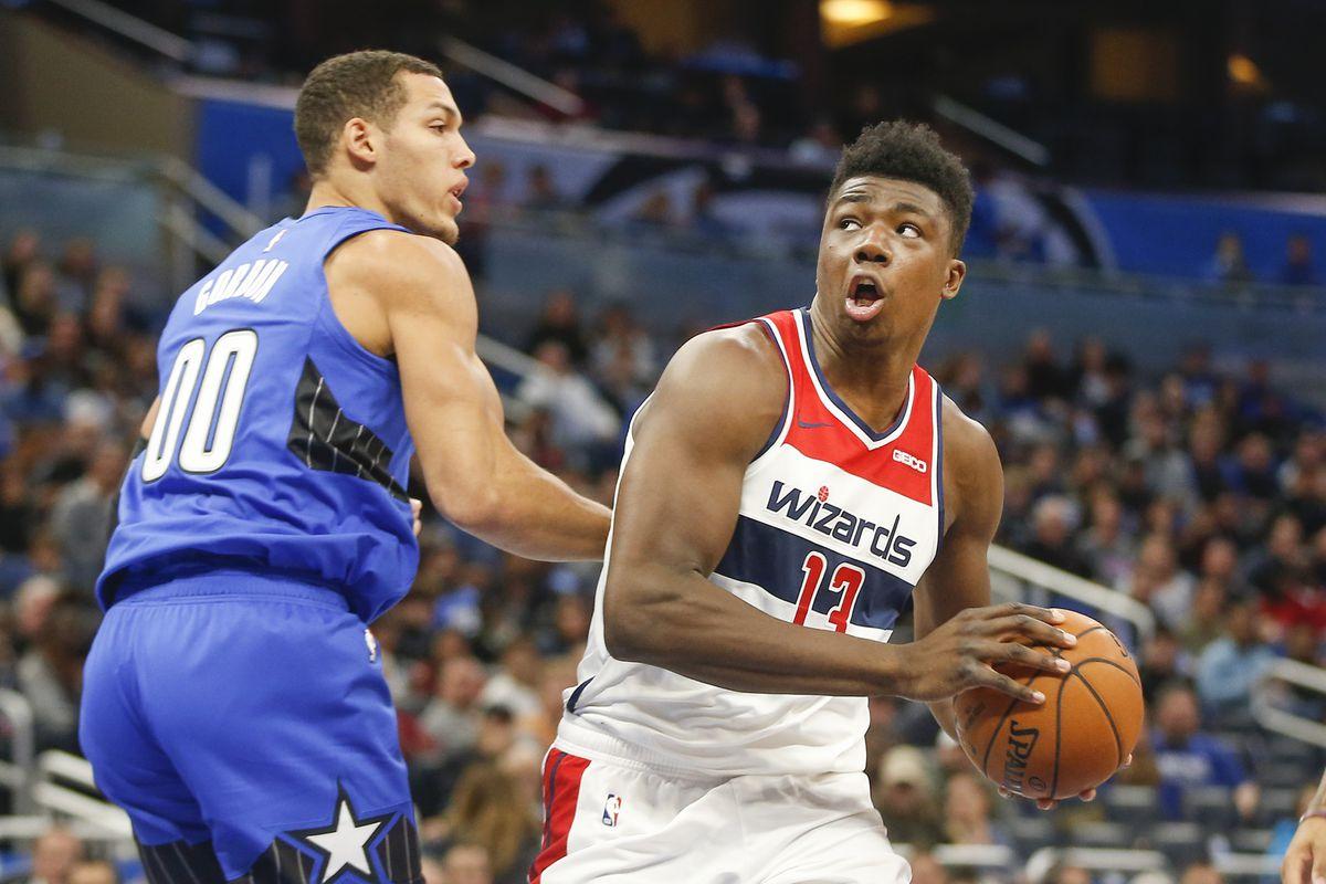 Washington Wizards center Thomas Bryant shoots the ball past Orlando Magic forward Aaron Gordon during the first quarter at Amway Center.