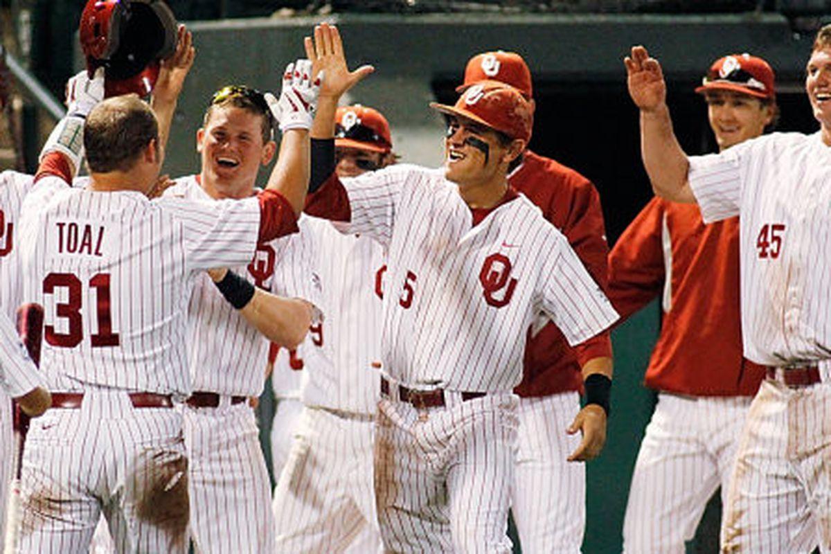 "via <a href=""http://cdn2-b.examiner.com/sites/default/files/styles/image_full_width/hash/15/a8/oklahoma-sooners-baseball_0.jpeg"">cdn2-b.examiner.com</a>"