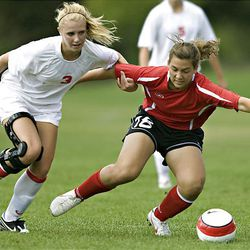 Park City's Rachael Ritter, left, and Bountiful's Katerina Skedros get linked up fighting for a loose ball as Park City hosts Bountiful in preseason high school soccer on Tuesday. Bountiful won 6-0.