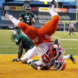 Sam Houston State  Tim Flanders (20) lands on his helmet after scoring  over Baylor defensive back Demetri Goodson (3) in the first half of an NCAA college football game on Saturday, Sept. 15, 2012, in Waco, Texas.