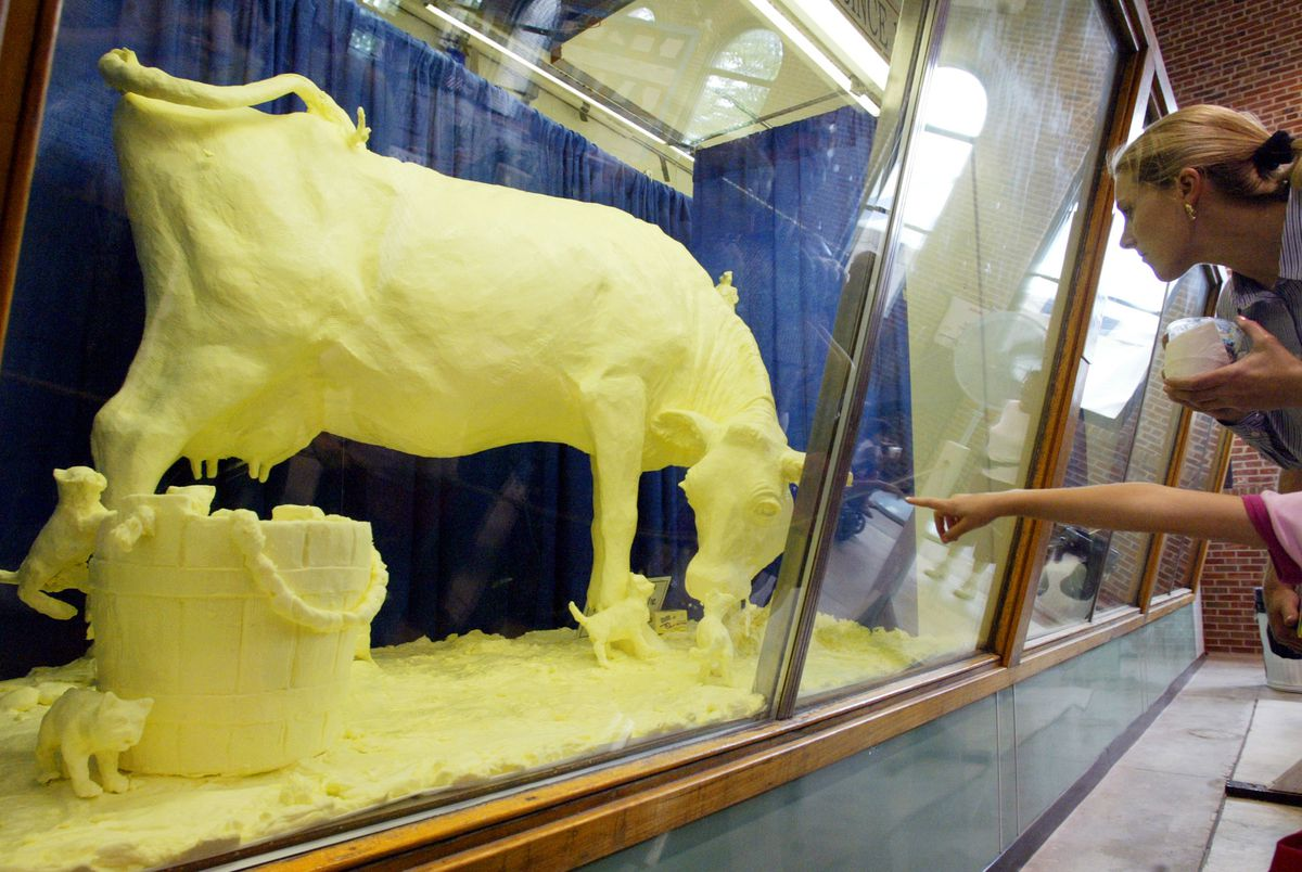 A fair-goer points to the butter cow at the Illinois State Fair in Springfield in 2004.